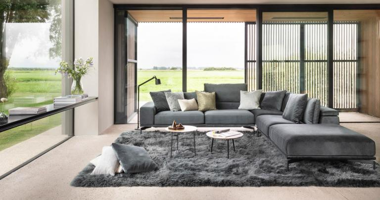 Grey sofa by Symphony Mills in a spacious living room